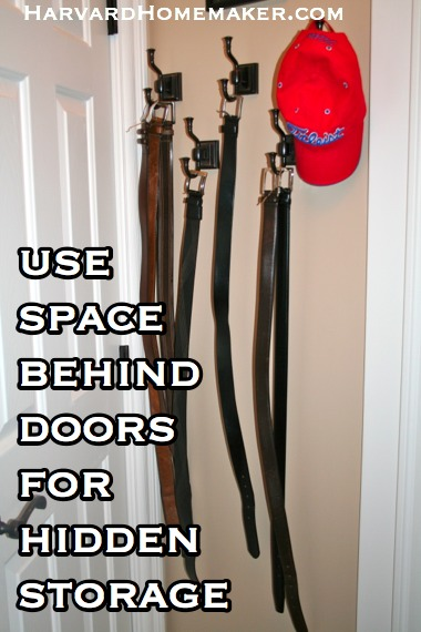 Use space behind doors for hidden storage